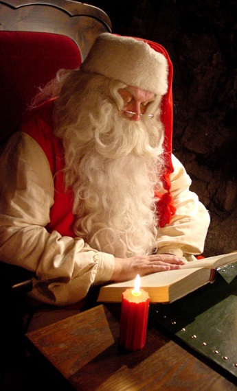 Santa Claus reading book